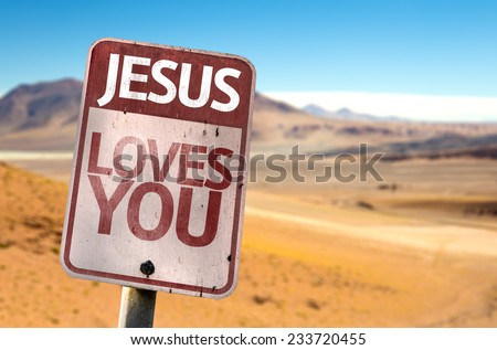 Jesus Loves You sign with a desert background - stock photo