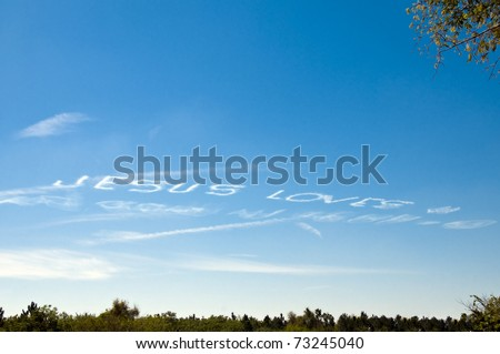 Jesus Loves You written in the sky by an airplane - stock photo