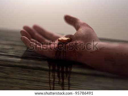 Jesus Nail-pierced Hand in focus - stock photo