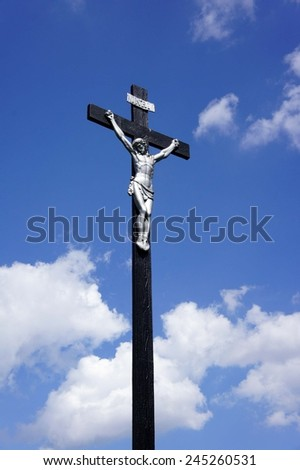 Jesus on the cross against a blue sky - stock photo
