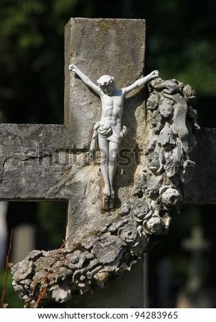 Jesus on the Cross, gravestone of the Zentralfriedhof cemetery in Vienna, Austria. - stock photo