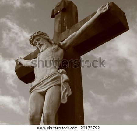 Jesus on the Cross in sepia - stock photo