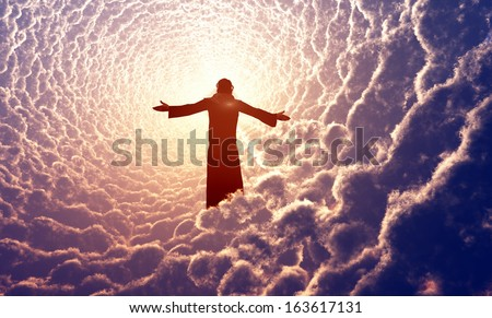 Jesus prays in the clouds. - stock photo