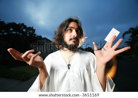 Jesus raising hands with a blank business card. - stock photo