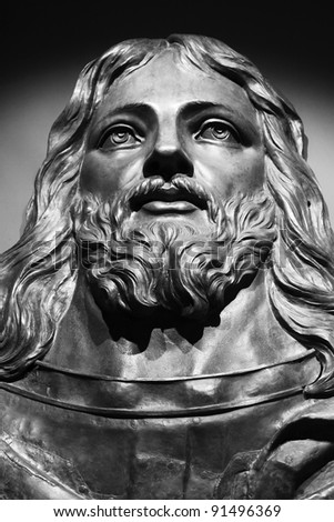 Jesus sculpture in stone and Black and White - stock photo