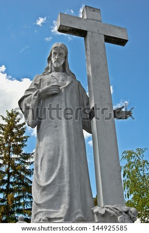 Jesus sculpture / This Jesus sculpture is in the cemetery of Kom�¡rom, Hungary.  - stock photo