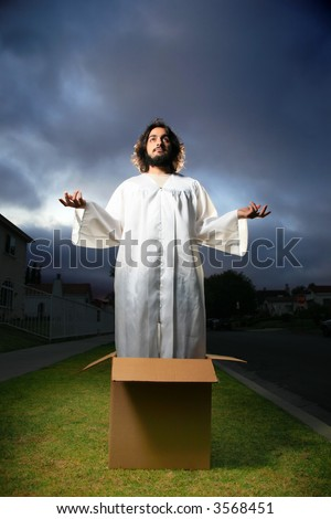 Jesus standing in the box with hands raised.