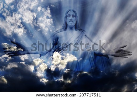 Jesus standing in white and gray storm clouds in blue sky with rays of light - stock photo