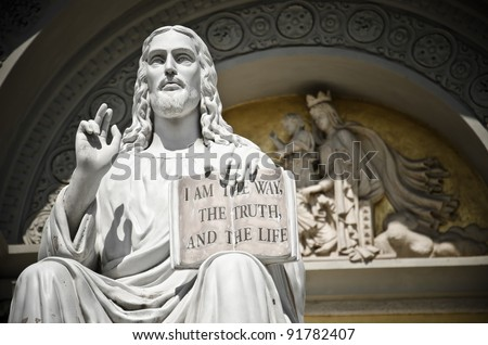 Jesus statue with the quote book - stock photo