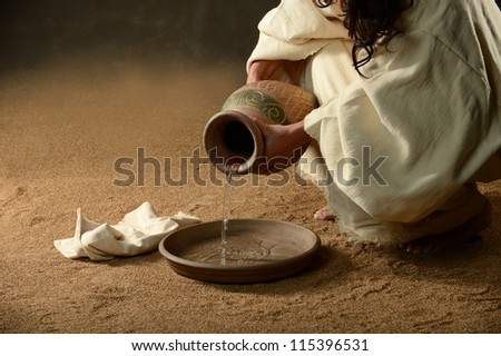 Jesus with a jug of water and a towel - stock photo