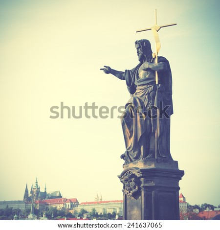 Jesus with cross on Charle's bridge in Prague, Czech republic. Instagram style filtred image - stock photo