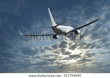 Jet above the clouds.Airplane flying in the sky  - stock photo