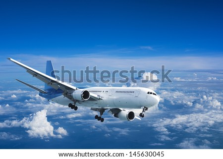 Jet aircraft above the clouds - stock photo