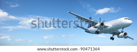 Jet aircraft in a blue sky. Panoramic composition. - stock photo