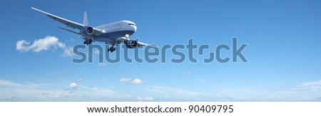 Jet aircraft in a blue sky. Panoramic composition in high resolution with a lot of copy space. - stock photo