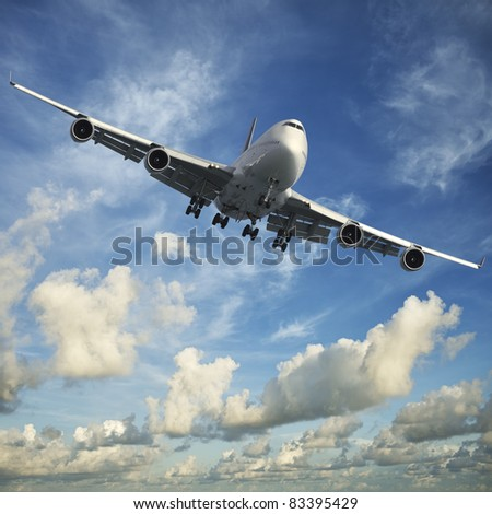 Jet aircraft in a morning sky - stock photo