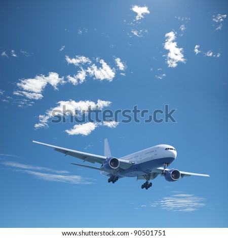 Jet aircraft in a noon sky. Square composition. - stock photo