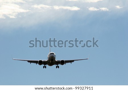 Jet aircraft in a sky - stock photo