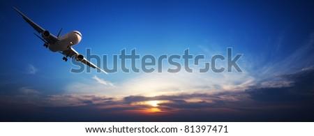 Jet aircraft in flight. Panoramic image. - stock photo