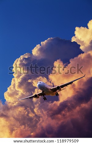 Jet aircraft in flight. Vertical composition. - stock photo