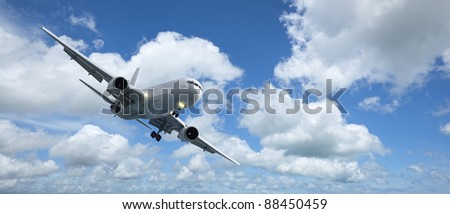 Jet aircraft is maneuvering for landing. Panoramic composition in high resolution. - stock photo