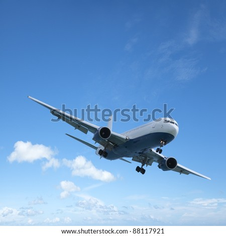 Jet aircraft is maneuvering for landing. Square composition with a lot of copy space. - stock photo