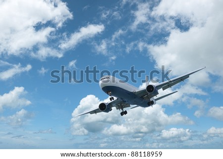 Jet aircraft is maneuvering in a blue cloudy sky. In high resolution.
