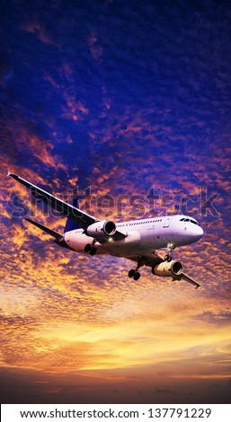 Jet aircraft maneuvering in a sunset sky. Vertical panoramic composition. - stock photo