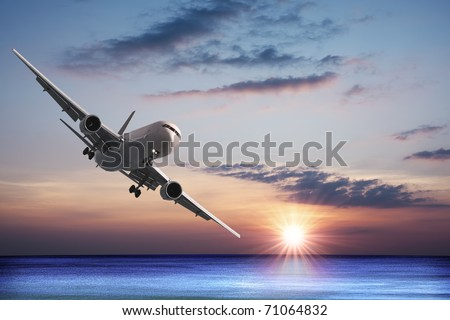 Jet aircraft over the sea - stock photo