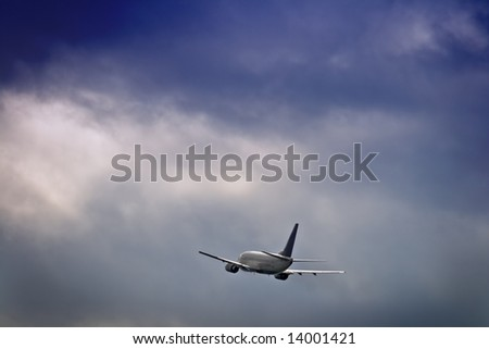 Jet airliner against stormy sky