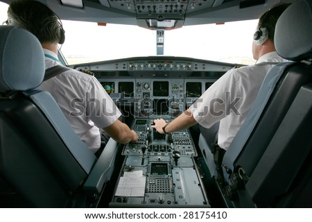 jet airplane at takeoff with two pilots - stock photo