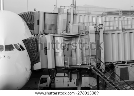 Jet airplane docked in Airport - stock photo
