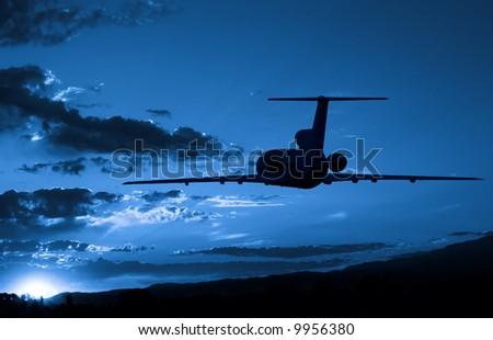 Jet Airplane flying to sunrise - stock photo