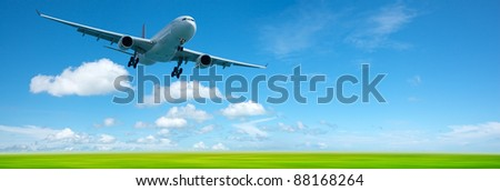 Jet airplane in a sky. Panoramic composition in high resolution. - stock photo