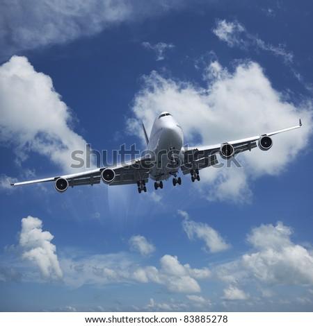 Jet airplane in flight - stock photo