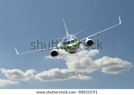 Jet airplane in flight on a beautiful day with blue sky and a few white clouds - stock photo