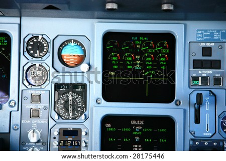 jet airplane instruments in cockpit - stock photo