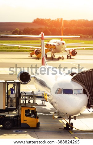 Jet airplane is on the runway prior to departure - stock photo