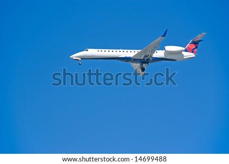 Jet airplane landing - stock photo