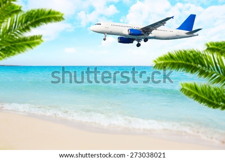 Jet airplane landing over the sea beach. Final approach. Vacation destination. - stock photo