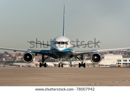 Jet airplane on the runway - front view - stock photo