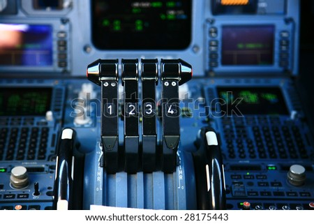 jet airplane throttle in the cockpit - stock photo