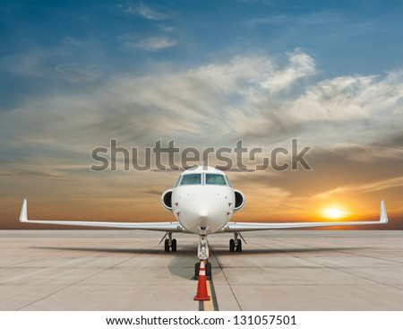 Jet airplane with sunset - stock photo