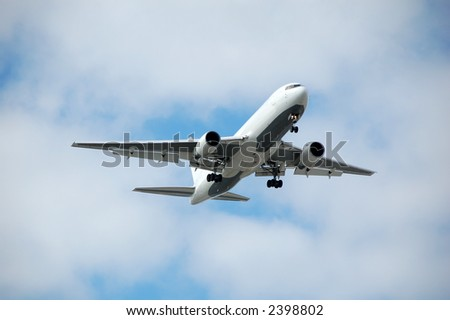 jet approaching airport - stock photo