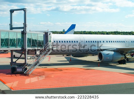 Jet bridge from an airport terminal gate. - stock photo