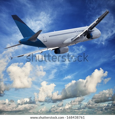 Jet cruising in a blue cloudy sky - stock photo