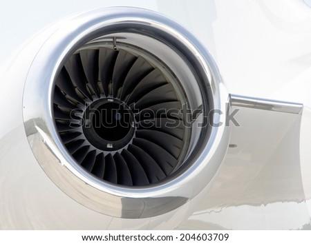Jet Engine closeup on a modern private jet airplane - stock photo