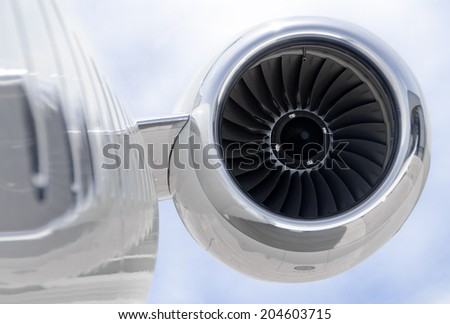 Jet Engine closeup on a modern private jet airplane - stock photo