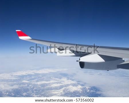 Jet flying above swiss alps - stock photo