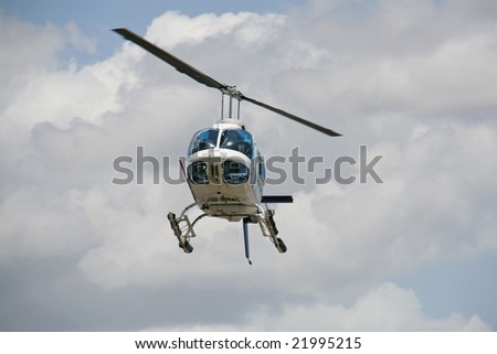 jet helicopter landing against cumulus clouds. room for text.